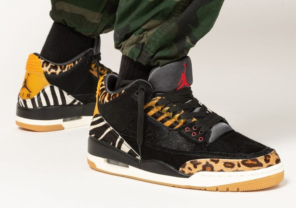 Person wearing mixed animal print Air Jordan 3 sneakers